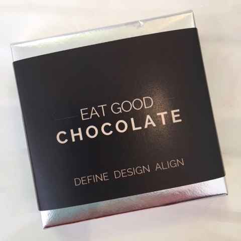 A chocolate bar with a label reading: EAT GOOD CHOCOLATE