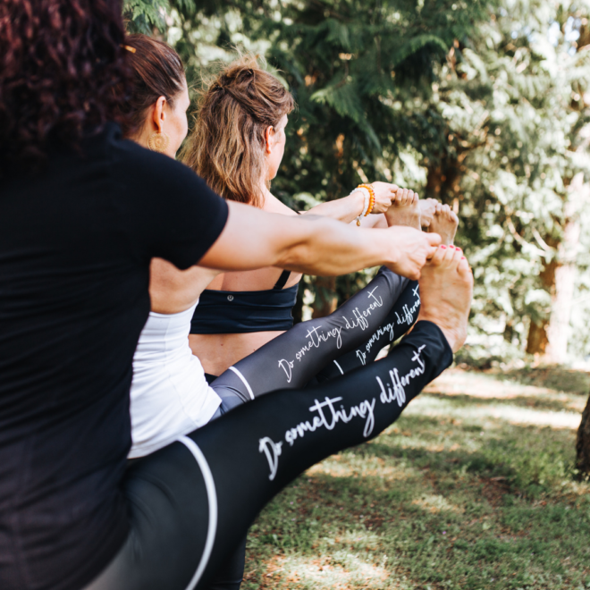 3 people standing in a yoga pose. The side of their leggings read: Do something different
